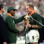 Francois Pienaar receives the World Cup from Nelson Mandela