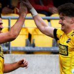 Hurricanes wing Kobus van Wyk celebrates his try with Jordie Barrett