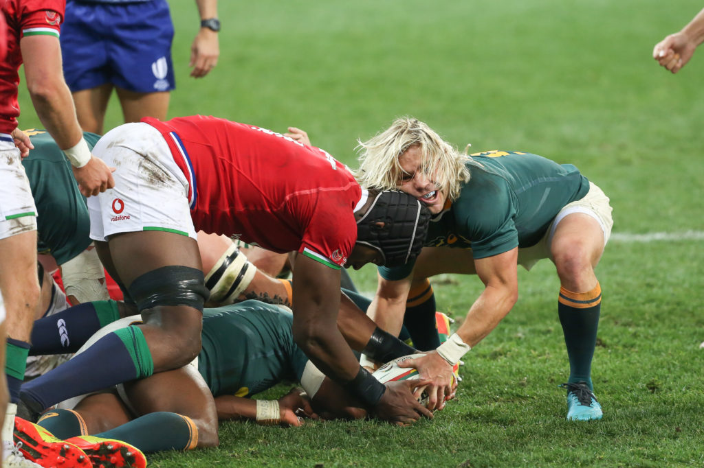 Faf de Klerk of the Springboks fighting with Maro Itoje of the B&I Lions for the ball during the Castle Lager Lions Series 1st Test match between South Africa and British and Irish Lions at Cape Town Stadium on July 24, 2021 in Cape Town, South Africa.